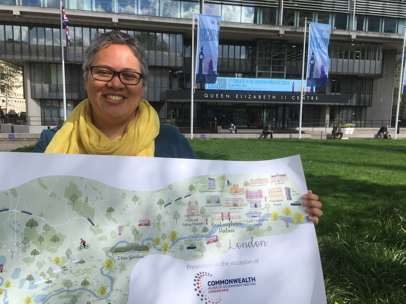 Caroline Robinson, Founder & Lead Cartographer, holding illustrated map along the River Thames from Windsor to Central London