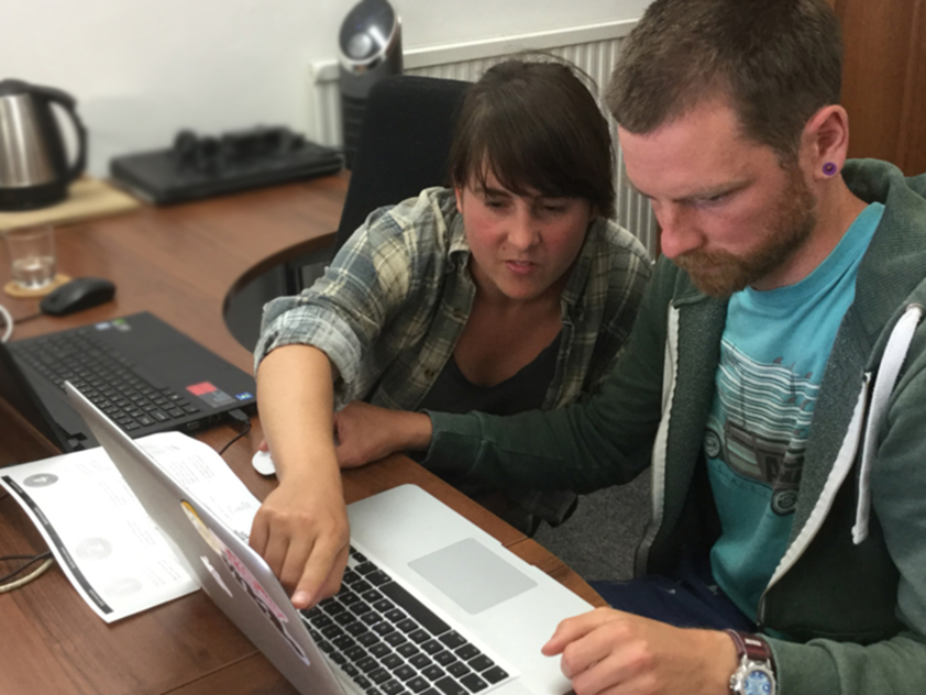 Two people helping each other with GIS